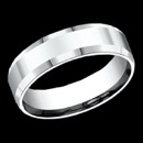 A stylish 14k white gold 6mm comfort-fit high polished carved design band features a slight beveled edge for a classic look. This ring is priced at a size 10, but can be made in other sizes. Price may vary depending on finger size.