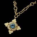 Cathy Carmendy 20kt. gold, seed pearl, and aquamarine pendant on a handmade chain.