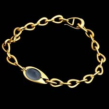 From Michael Bondanza an eyecatching yellowgold bracelet set with a 3 carat Blue Chalcedony.