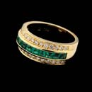 Pictured is an 18kt gold, emerald, and diamond Gumuchian ring. The ring measures 8.0mm in width. Available variations feature ruby or sapphire gemstones.