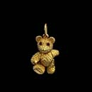A very cute Robert Bielka 18kt. gold baby bear with ruby eyes. The arms, legs and head all move. Very solid piece measuring 7/8''. Available in a large size 1 1/8'' for $3,450.00.  Made in the USA and solid!