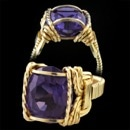 A very nice 14kt gold ''all hand crafted'' Amethyst finger ring circa 1950's The ring is set with a fine 13,5mm x 11.0mm modified cushion Amethyst. Interesting period piece and appears that it never has been worn. Size 6 3/4. You'll like this!