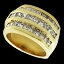 A very fine 14kt yellow gold diamond channel set ring. The piece is set with 30 princess cut diamonds weighing total 2.53ct. Diamonds are SI clarity and G-H color. The ring is 12.4mm width tapering to 7mm. Weight is 10.8 grams and a size 5 1/4. Ring is from the 1980's. Very fine condition.  $6200.00 appraisal from the 90's