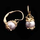 Wow, luxurious 20kt gold and pearl earrings from designer Cathy Carmendy. These  earrings are set with 7mm pearls. The earrings have lever backs.