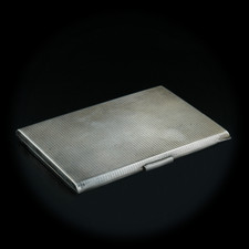 A beautiful, vintage sterling silver cigarette case. This piece has a machined engraving on the outside and a highly pollished inside.  This cigarette case measures 4 5/16 inches wide, 3 1/4 inches long, and a slim 3/8 inches. 4.96 oz weight. 1940's
