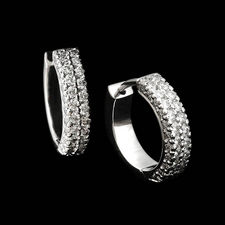 Michael B.'s platinum double row flat band huggie diamond earrings. The earrings contain 90 diamonds weighing .62ct total.  These beautiful pieces measure 3mm in width and 13mm in height.