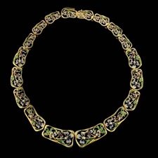 This wonderous 18kt yellow gold Nouveau Collection necklace comes alive with intricate blue and green enamel.