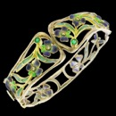 A stunning combination of color and design. This bracelet has an art nouveau inspired design. It was 6 diamonds and 2 emeralds. The piece is made from 18k gold and sterling silver.