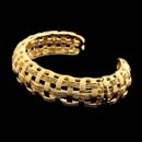 Yuri 18kt yellow gold woven cuff bracelet in looped pattern.  This piece is hinged on one side to make it a more comfortable piece.