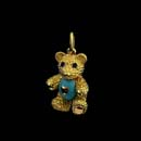 A very cute 18kt. gold movable baby bear with blue enameled tummy and sapphire eyes. The belly is a fired enamel with gold heart. This is the small size 7/8''. Available in 1 1/8'' for $3550.00 Made in the USA and solid!