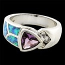 A beautiful ladies sterling silver ring. The ring is set bezel set with a triangular shape brilliant cut amethyst. In addition inlaid on the shank should to one side is opal and channel set on the other side are 3 round brilliant cut diamonds. 