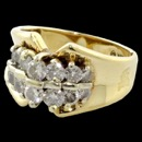 A gorgeous 10k yellow gold two row of diamonds ring. There are 14 diamonds altogether on this ring. The diamonds have a color of G-H and a clarity of I1 The ring measures 11.63mm at the highest part of the ring and  4.11mm in height at the lower part of the shank. Weighs 3.67 grams. This ring is a size 6.75, but can be sized to what ever size you want.