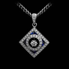 This beautiful pendant shines with .27cts. in diamonds and .50cts. in sapphires.