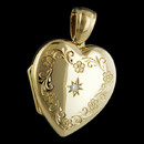 Show her the love and give her your heart with this Charles Green classic hand-engraved locket.  The locket is made in 18kt gold and set with a single .03ct diamond. This locket measures 23mm x 21mm.