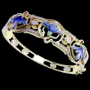 A beautiful blue enamel 18k gold art nouveau inspired bracelet. This is truly a design you will not see anywhere else. There are 38 diamonds throughout the bracelet with a total carat weight of 0.85tcw. The piece measures 58mm x 68mm and weighs 39.9 grams.