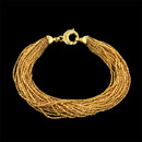 This sparkly 18kt yellow gold bracelet is by Yuri Ichihashi and contains 22 strands of woven gold.  The piece is secured by a lobster clasp and measures 7 1/2 inches in length.