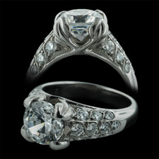 Beautiful platinum engagement ring by Gumuchian, set with .73ctw of diamonds. The ring needs a minimum 2.0ct center diamond.  All diamonds are VS F-G.  Elegant tulip prongs grace the stone.