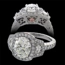 A gorgeous custom platinum oval diamond engagement ring made by Bridget Durnell. This ring features a oval center diamond with two cadillac shield cut diamonds on the side. The undercarriage of the ring has a hand engraved floral pattern along with a pink diamond. Price does not include center diamond.
