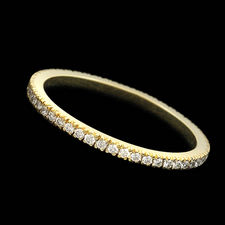 14kt yellow gold 1.5 mm round diamond eternity wedding band from Scott Kay, with .25ct total weight.