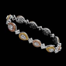 This beautiful Michael Beaudry bracelet shines with unique fancy pink, lily, and yellow diamonds. Call for price and availability.