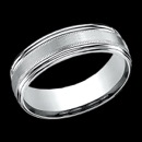 A stylish 14k white gold mens wedding band. This ring is 7.5mm in width and features a modern design along the center. The price is for a size 10, but can be made in other sizes. Price may vary depending on finger size.
