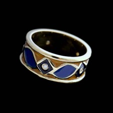 18kt yellow gold orange and blue enamel ring with 5 diamonds .065cts.