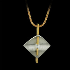 This beautiful modern design is 18kt yellow gold and platinum.  The diamond is a .25ct. princess cut with a clarity grade of VS and color of F-G.  The piece is suspended on an 18kt yellow gold 18 inch tinsel chain.