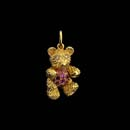 18kt. gold movable baby bear with pink sapphire tummy and diamond eyes. This piece is available in 7/8th inches as pictured and 1 1/8 inches for 3,725.00.  Arms, legs, and head moves.  Just adorable.  Very solid pieces. Made in the USA