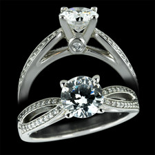 Platinum split shank micro pave diamond engagement ring. Set with 0.18ctw diamonds and 4.0mm wide. Accommodates a 1.0ct and up center diamond, not included.
