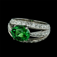 18kt white gold ''Luna'' ring by Gumuchian is set with a vivid green Tsavorite garnet.  The Tsavorite weighs 3.12ct. and is surrounded by pave' set diamonds with a total weight of 1.45ct.  The diamonds are VVS F ideal cut.  12mm width.