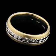 Classic Michael Beaudry gent's platinum and 18k yellow gold wedding band, with engraved detailing in the center. 6 1/2mm width. Please call for current pricing information.