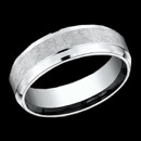 A modern design 14k white gold 7mm mens wedding band from Benchmark. This Benchmark mens ring features a drop edge along the corners of the ring and has a brush finish in the center. The ring is priced for a size 10, but can be made in other sizes. Price may vary depending on finger size. This Benchmark ring is made in USA.