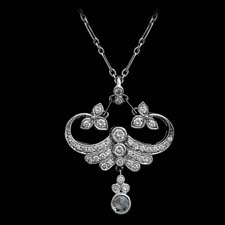 This gorgeous <i>Fleur de Lys</i> pendant shines with over a half a carat in diamonds.