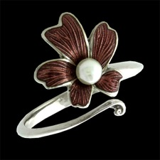 A Nicole Barr floral enamel pearl ring. The center is an akoya pearl. The color of the enamel flower is a brownish red. The flower measures 13.75 x 13.65mm.