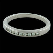 Ladies Platinum diamond channel set band containing .30ct. total weight in diamonds.