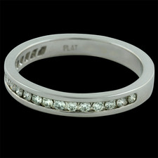 Platinum diamond channel set band with .14ct. total weight of diamonds. Size 6.25