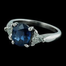 Sasha Primak platinum and diamond engagment ring with .50ctw in side trillion diamonds and 2.50ct oval sapphire center stone. The size is 6 3/8 and the shank tapers from 3 to 2mm.