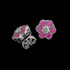 These adorable 18k white gold earrings feature pink sapphire petals and diamond center stones.
