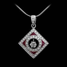 This gorgeous platinum pendant shines with .25cts. in rubies and .62cts. in diamonds.