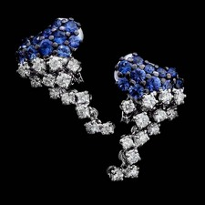 Blue luster: These elegant 18kt white gold diamond and blue sapphire cluster earrings from Damiani contain 1.22ctw in diamond and 2.20ctw in sapphires.
