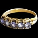 A very nice 14kt gold (stamped marked JSS) natural Tanzanite 5 stone ring circa 1980''s The ring is set with five round Tanzanites measuring 3.45 x 3.5mm each. The color s a medium light pastel blue color. The ring measures 5.5mm and tapers to 2.0mm at the base. Size 6 3/4 and is in excellent condition.