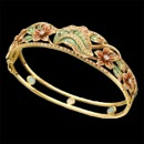 A beautiful enamel and diamond bracelet with a gorgeous art nouveau inspired design. This bracelet is made from solid 18k yellow gold. There are 56 diamonds placed throughout this bracelet, with a total carat weight of 0.58tcw. The size of the bracelet measures 17mm by 180mm. The enamel leafs feature green and red with a gradient of yellow from the gold.