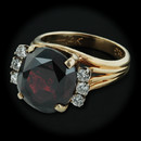 A stunning 14kt yellow gold and almandite garnet ring. The ring is set one oval faceted 10.18ct garnet, and six full cut diamonds weighing .30cts.