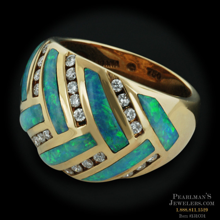 Item: 131CO1 - This 18kt yellow gold Kabana ring is set with 9 blue ...