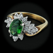 This gorgeous 18kt yellow gold ring is set with .60ctw of diamonds and also set with .60 cts. of green tourmaline with a width of 14mm and a size of 6.