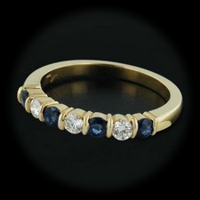 This gorgeous Jeff Cooper 18kt yellow gold band is set with .34cts of sapphires and .21cts of diamonds. With a thickness of 3.5mm and a size of 6 3/8.