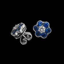 These sweet floral stud earrings feature sapphire petals (.93cts.) and a diamond center stone (.20cts.).