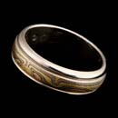 A classic 6mm 18kt yellow, red, and grey gold with etched sterling silver round edge wedding band by George Sawyer, finished with a white gold outer edge.