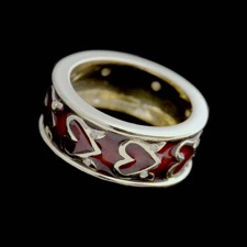 18kt yellow gold red enamel heart design ring with 16 diamonds.