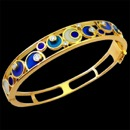 A pretty blue and teal color enamel 18k gold art nouveau bracelet. There are 8 round diamonds on this bracelet. The total carat weight of the diamonds is 0.28tcw.